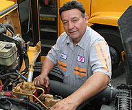 mechanic working on schoolbus